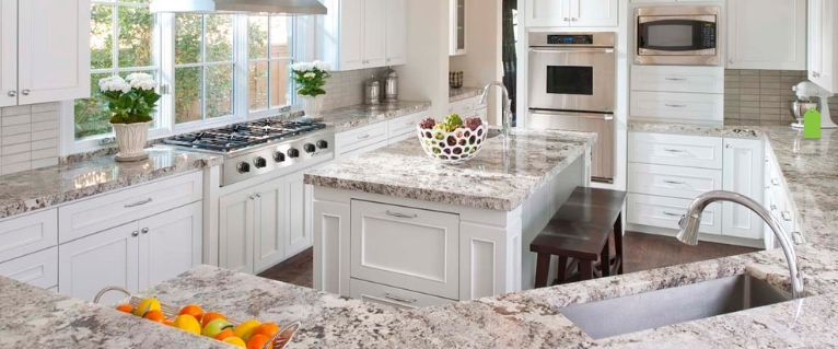 this is the alaska granite pattern paired with white cabinets in the
