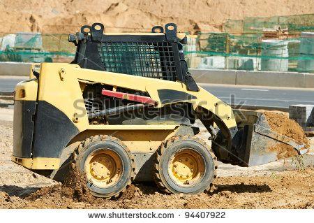bobcat machinery moving sand | skid steer loader moving sand