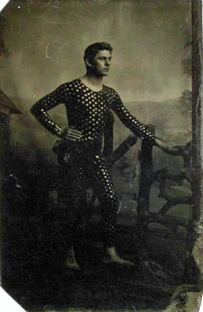 ca. 1875, [tintype portrait of an acrobat, striking a pose in his costume]  via the International Center of Photography
