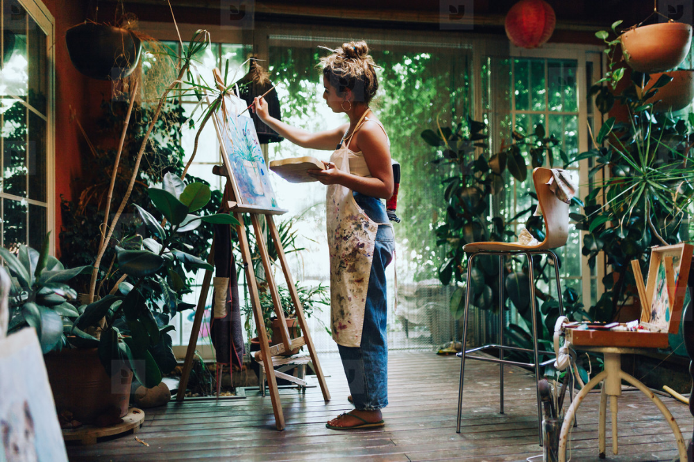 Photos - Woman painter painting in her painting studio. - YouWorkForThem