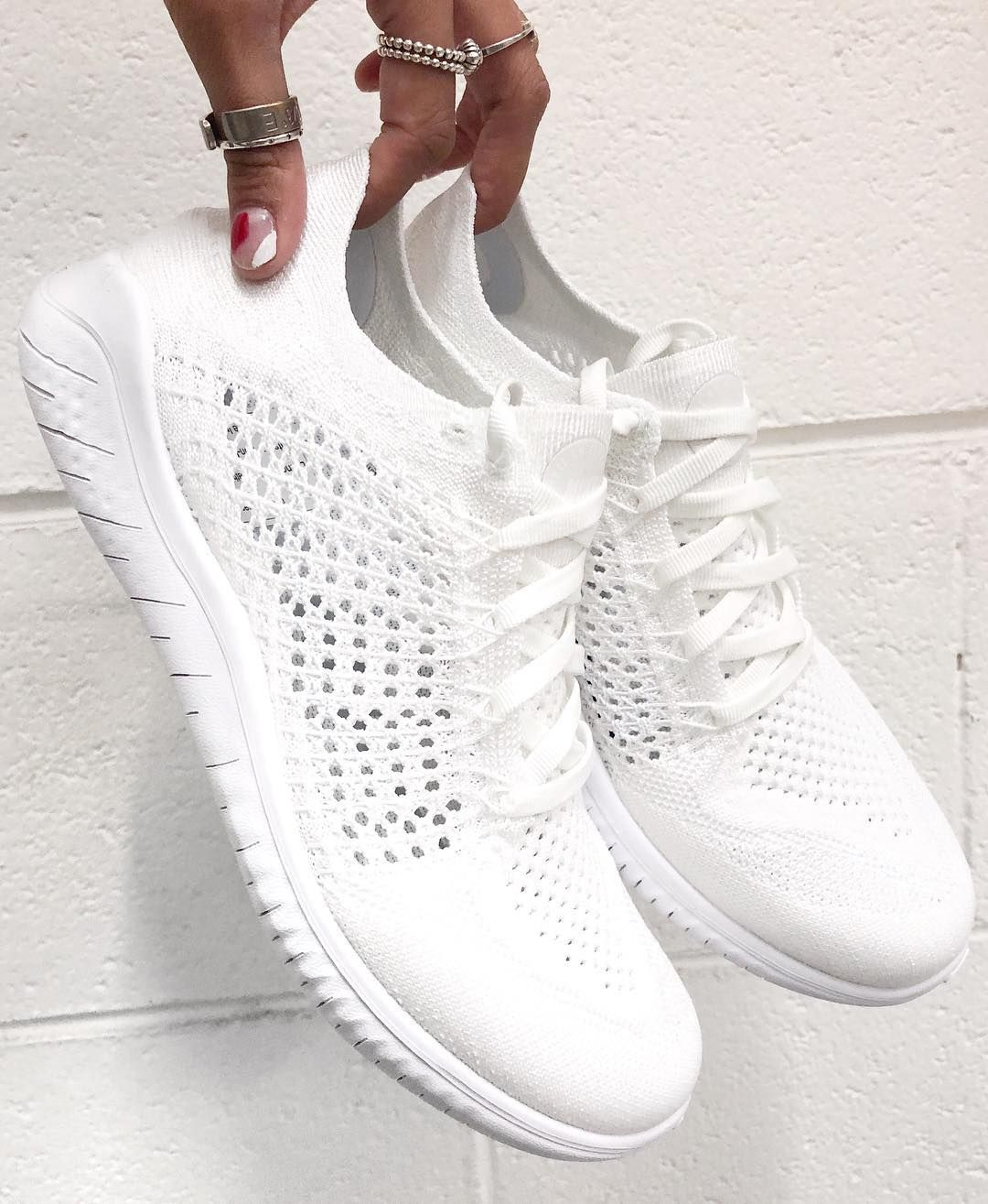 b8310a39ef10 We take a closer look at the stunning new Nike Free RN Flyknit 2018 Women s  Running Shoe in all white. It is the lightest trainer in the Nike Free RN  family ...