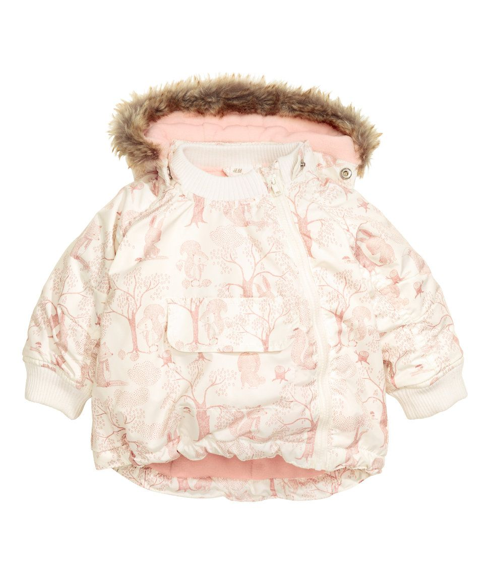 f59a09336769 Natural white/light pink. Lightly padded jacket with a printed pattern and  fleece-lined, detachable hood with faux-fur trim. Diagonal zip, mock front  pocket