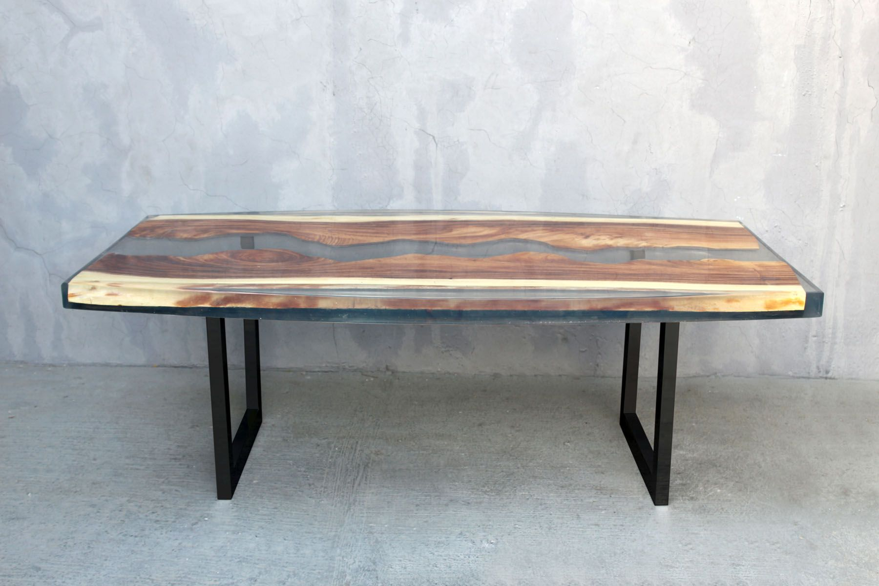 Acacia wood slab dining table with clear resin and black lacquered