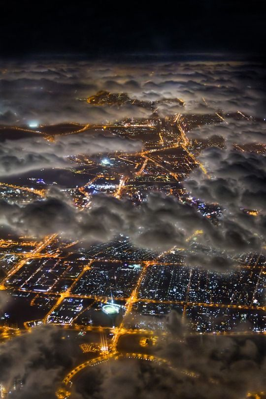 Flying over Dubai at night, by Guilhem De Cooman