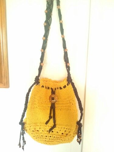 Drawstring hand crocheted purse with leather strap