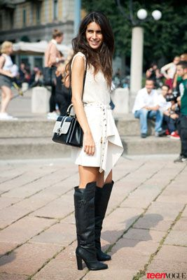 Milan Fashion Week. sweet white dress with a serious pair of black boots