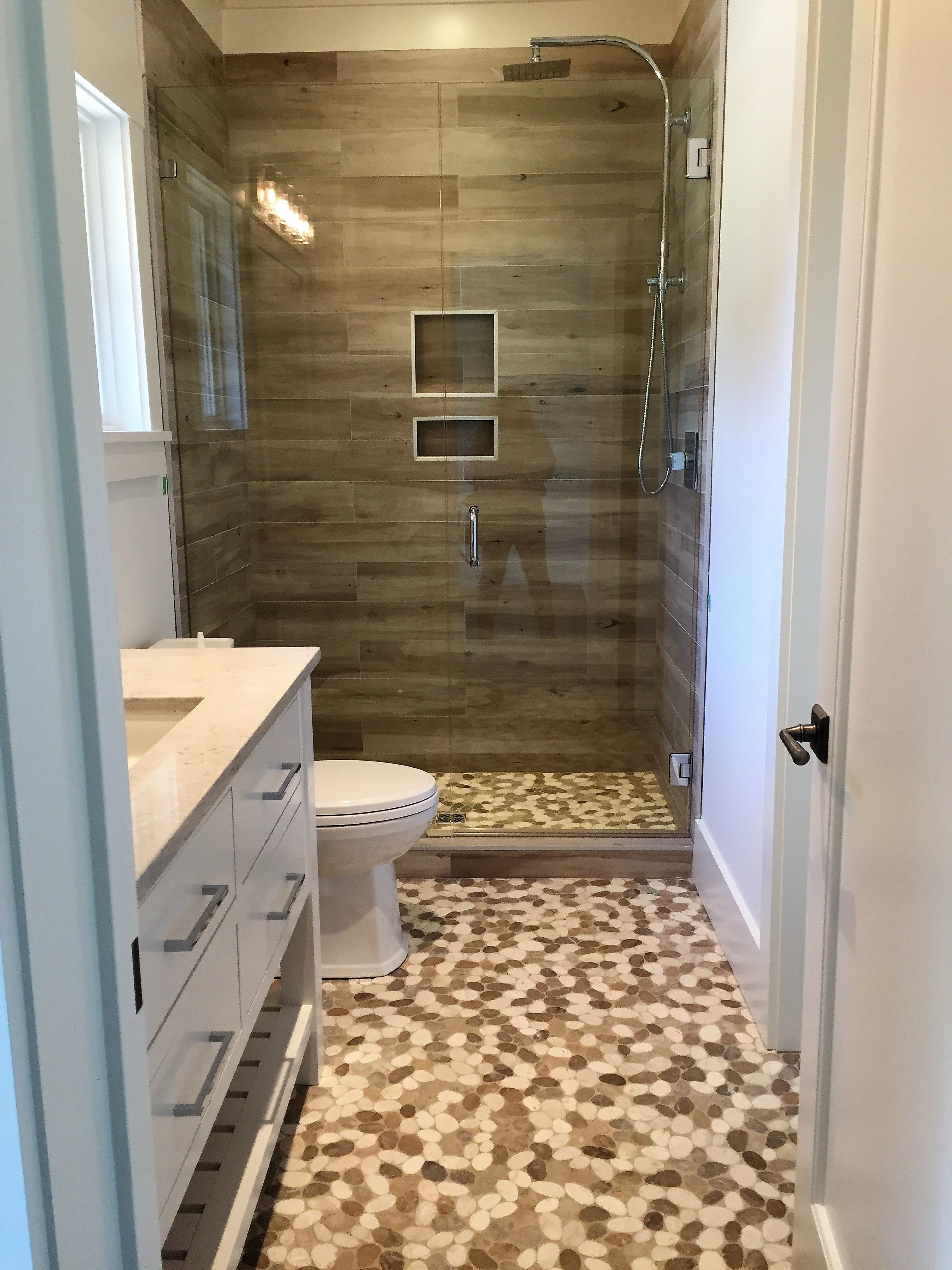 Pebbles On Floor And Wood Look Porcelain Plank Tile On Shower Walls Shower Wall Shower Tile Wood Plank Tile