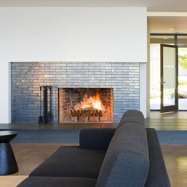 A Shimmering Hearth Integrated Beautifully Into A Remodeled 60s