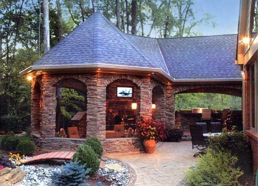 built in grill and separate island, brick pavilion and addition