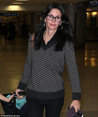 dfd549f709 Courteney Cox arriving back at LAX wearing black framed glasses ...