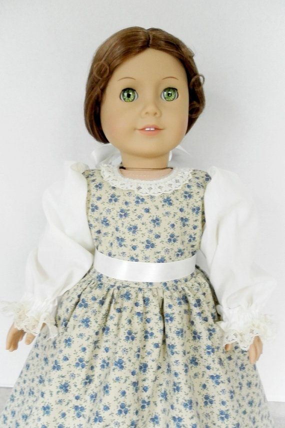 1774 American Girl Felicity Colonial Dress - Doll Clothes - Prairie, Pioneer, Ivory Apron - Wheat, Cornflower and Denim Blue Roses - 1027    Small rose print is perfect to relive the pioneer /colonial days, church or school clothes. Felicity or Kirsten will like wearing this outfit into the garden! Floor length dress was made with a calico blue rose print, contrasting ivory sleeves. Dress features a self-lined bodice, round neckline trimmed with ivory lace. Center back opens below the waist…