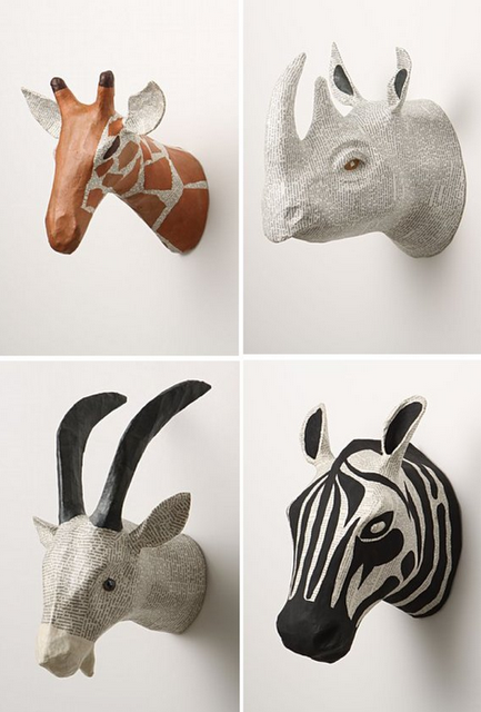 Animal heads... we could make a paper mache version to hang above the mantle of food table.