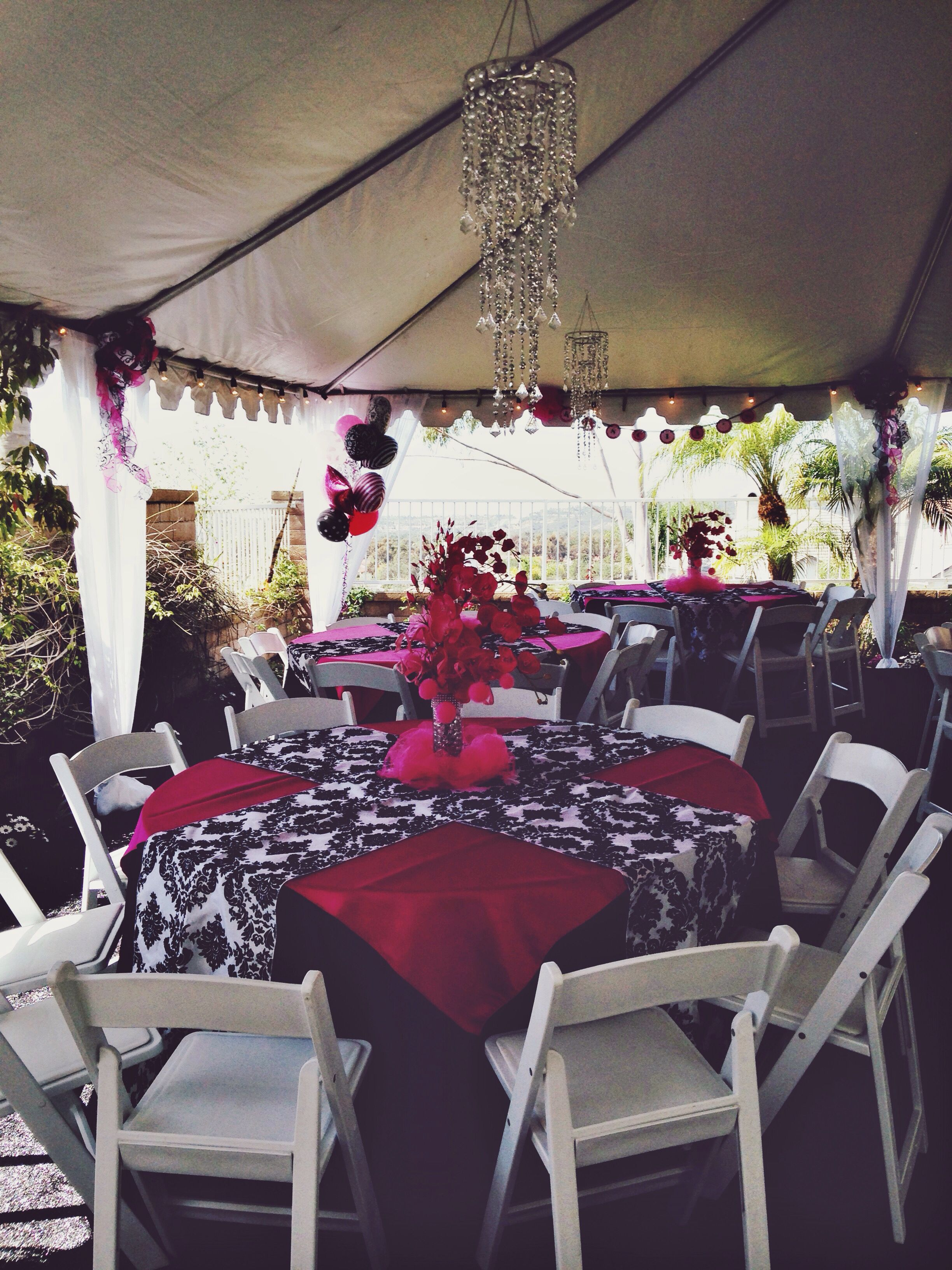 Baby shower: backyard event, white padded folding chairs, fuchsia ...