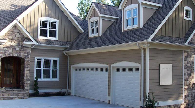 Woodsy house with Tesla solar roof top shingles and