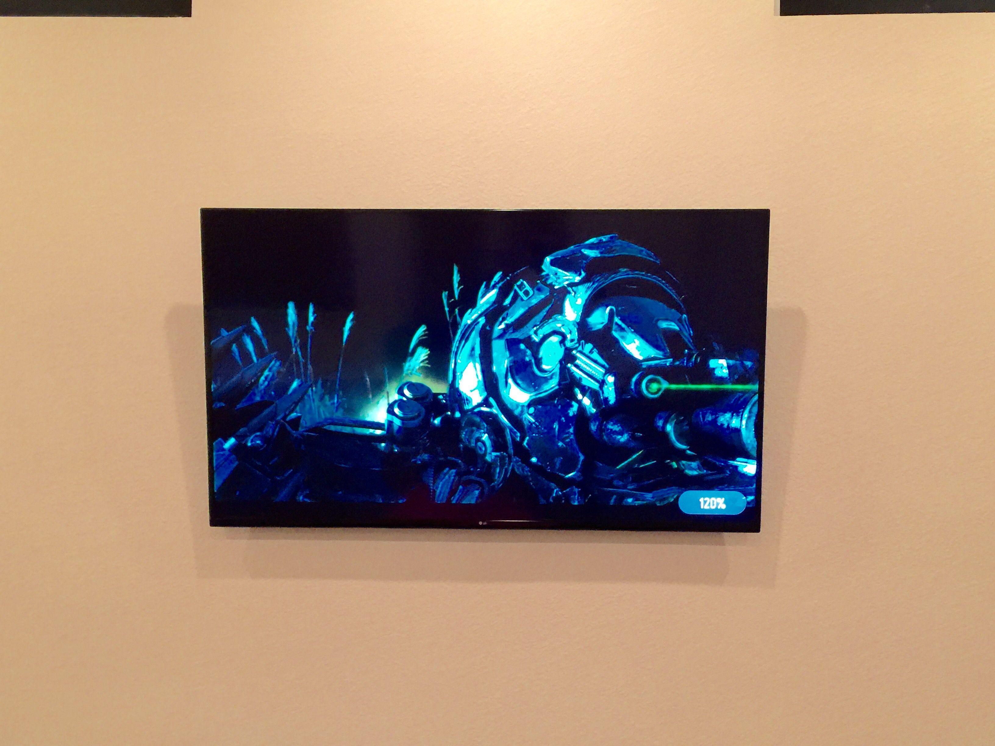 "75"" LG Smart LED TV on a Tilt Mount Wires Hidden in Wall"