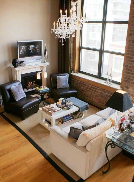 TV placement in small living room via Apartment Therapy, 2 light fixture  levels - House Decor Idea