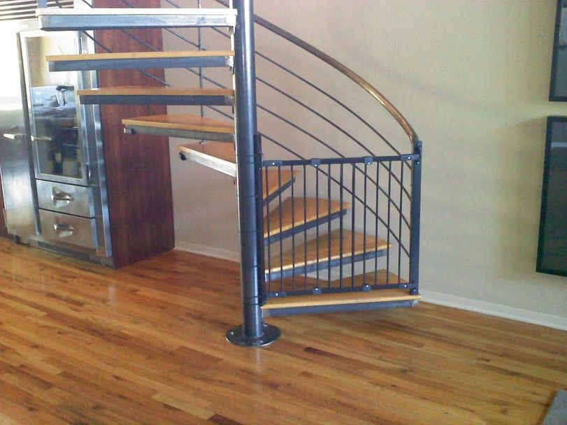 Best Black Gate Attached To Spiral Staircase Home Stairs 400 x 300