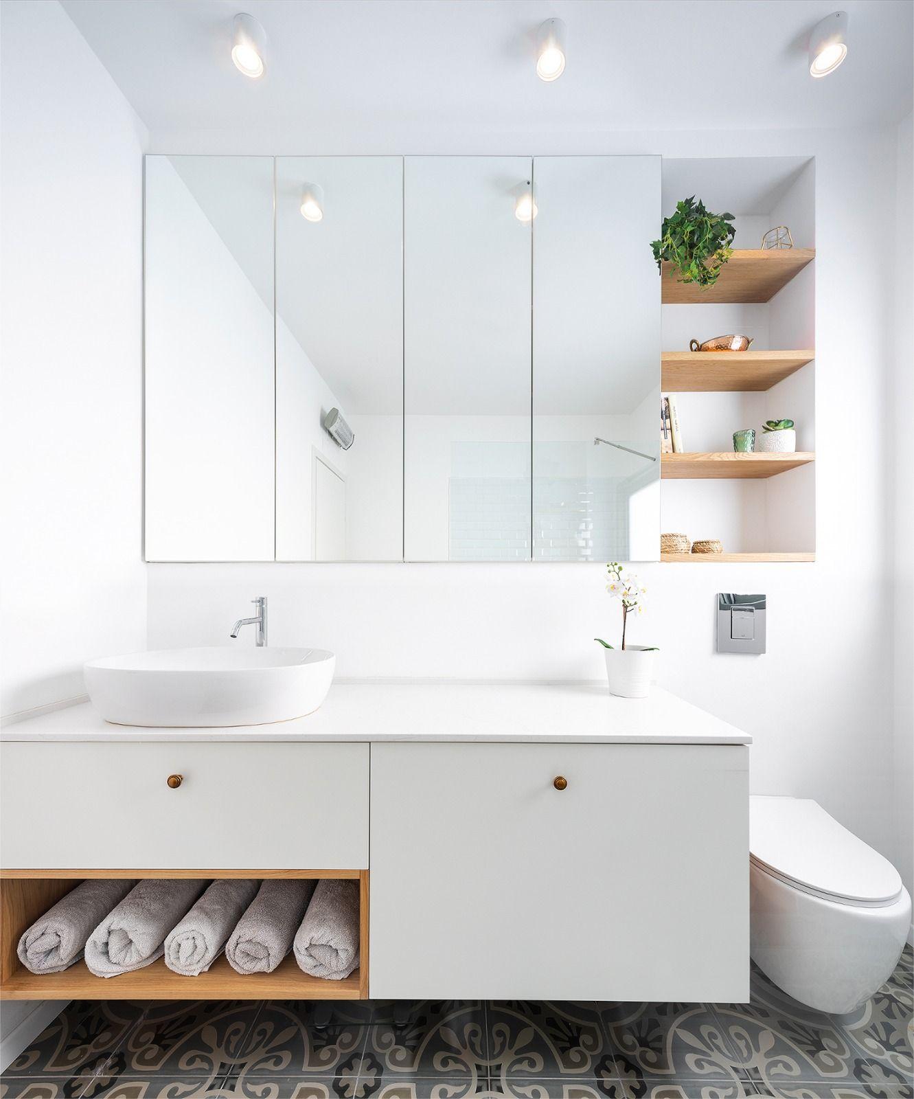 Modern minimalistic bathroom with hidden storage behind ...