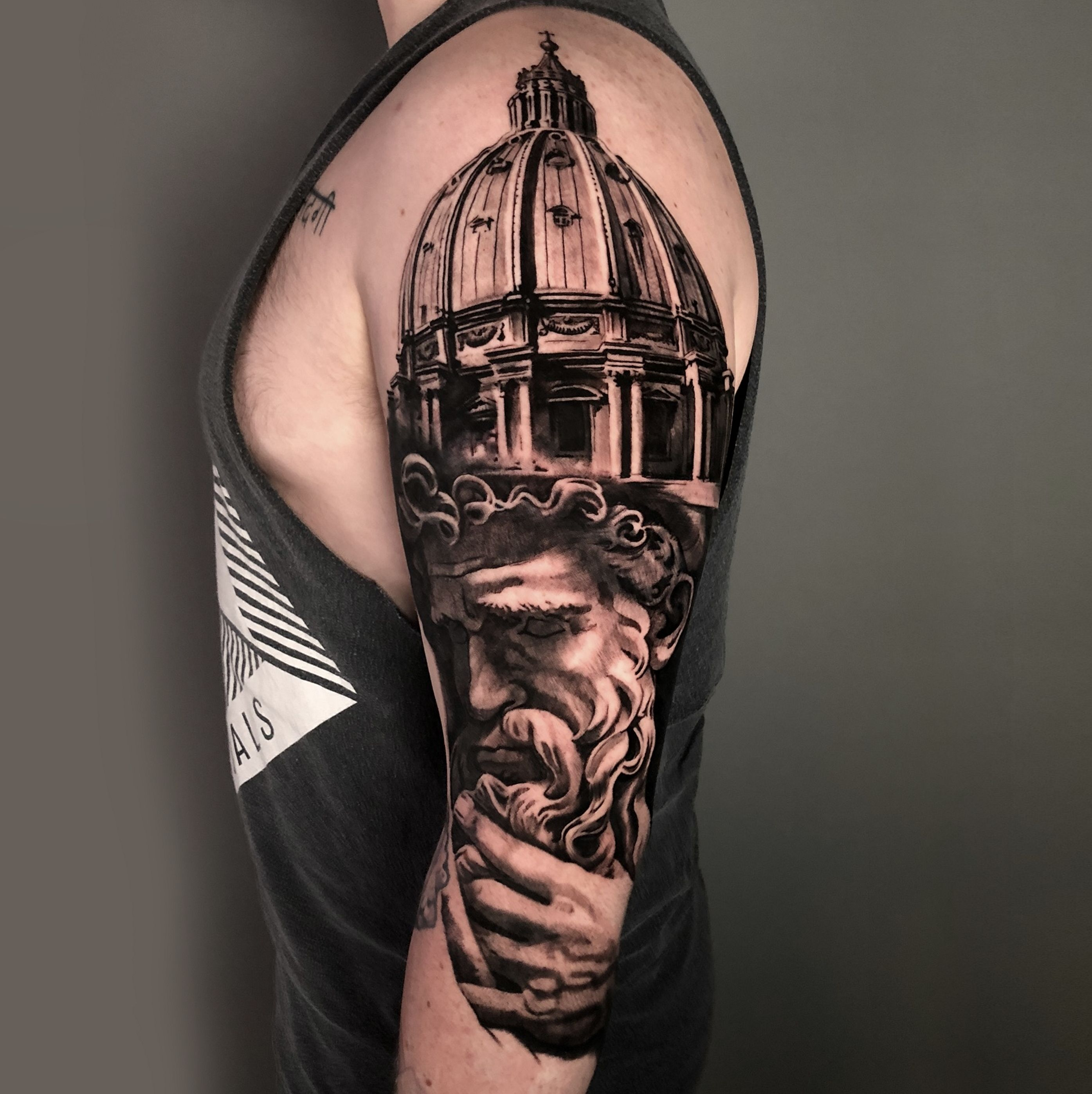 Black and grey realistic sleeve tattoo of saint peter