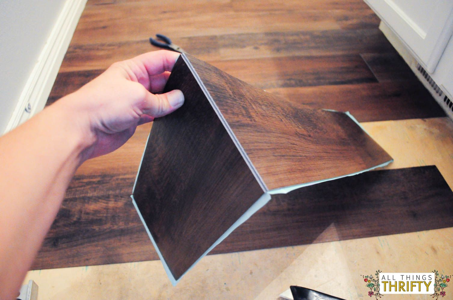 How To Easily Install Peel And Stick Vinyl Diy Kitchen Flooring Peel And Stick Vinyl Diy Flooring