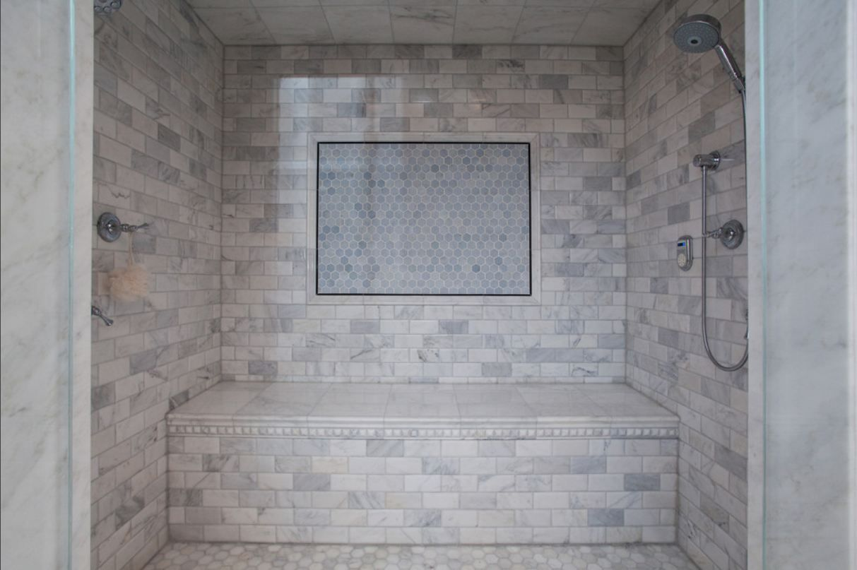 Stunning detail shot of chrome footed gray vanity over calcutta gold marble shower with calcutta gold marble subway tile shower surround marble tiles ceiling and hex marble tiles floor dailygadgetfo Gallery