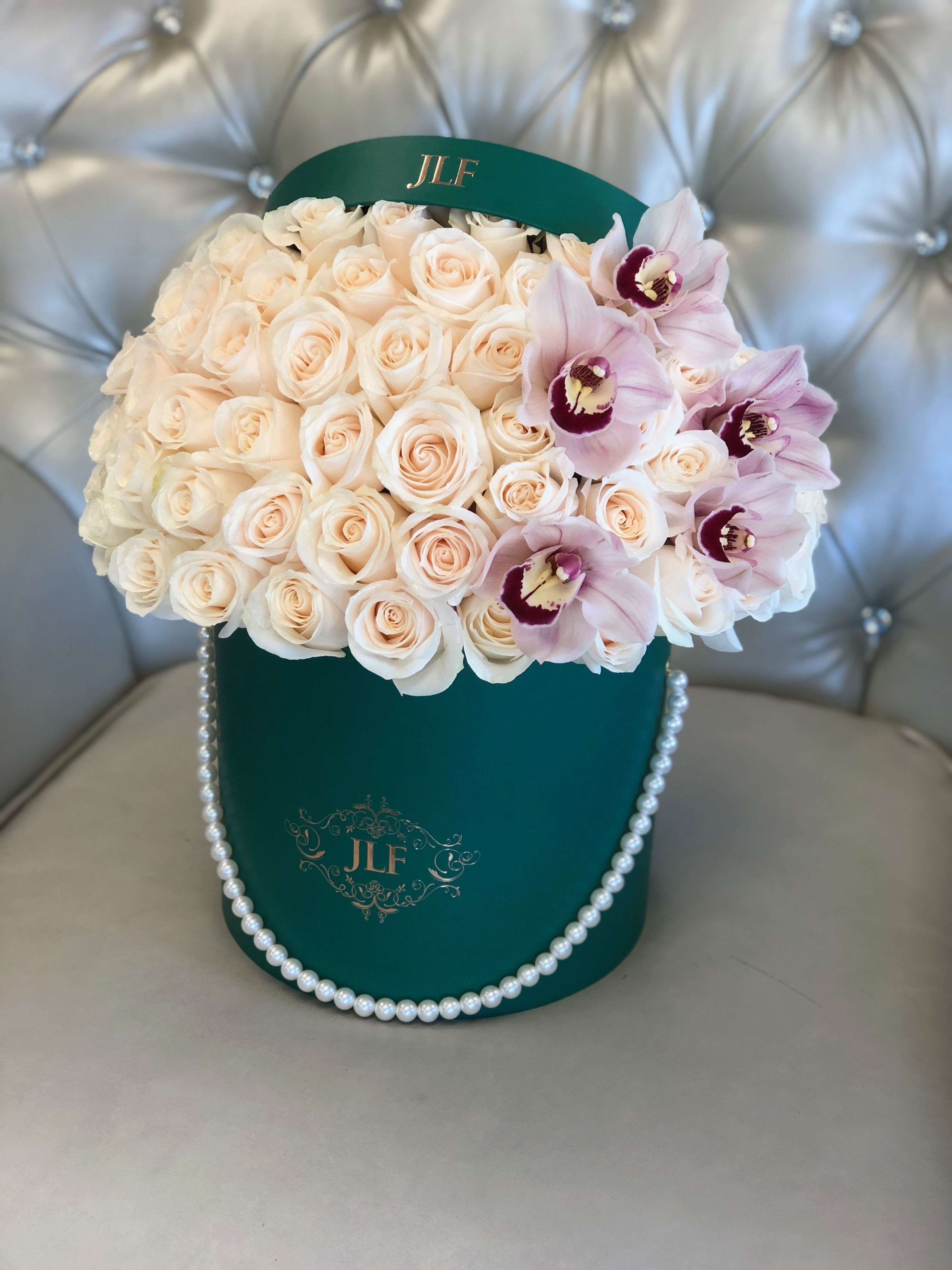 Signature 50 White Roses With Cymbidium Orchids Pearl Handle