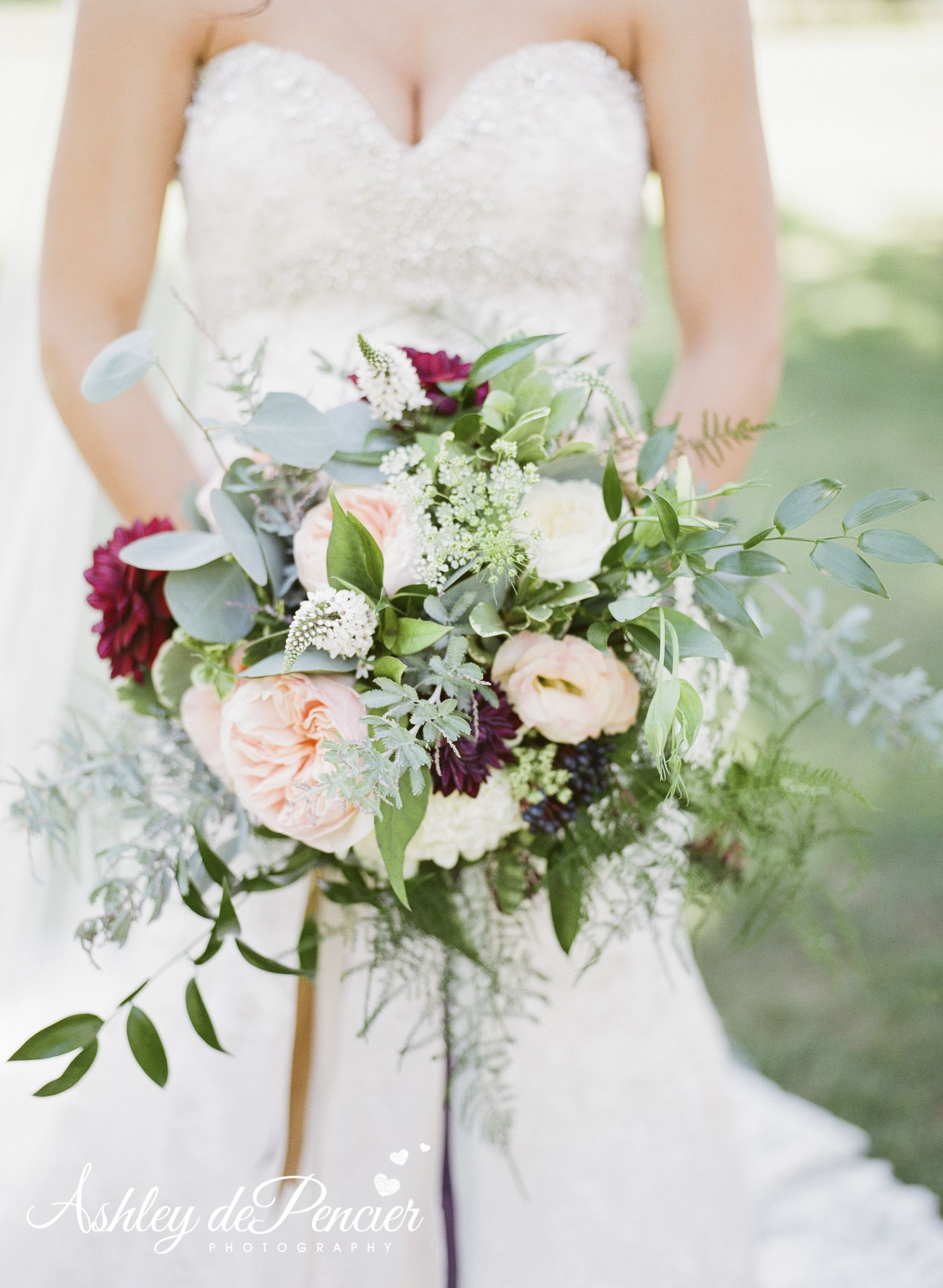 lush bridal bouquet with lots of greenery blush garden roses burgandy dahlias and ribbon