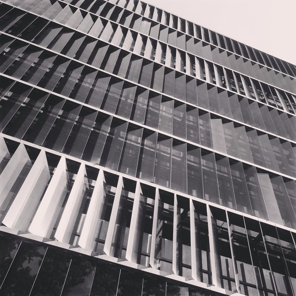 Glass Louver Facade : Vertical glass louvers on office building in barcelona