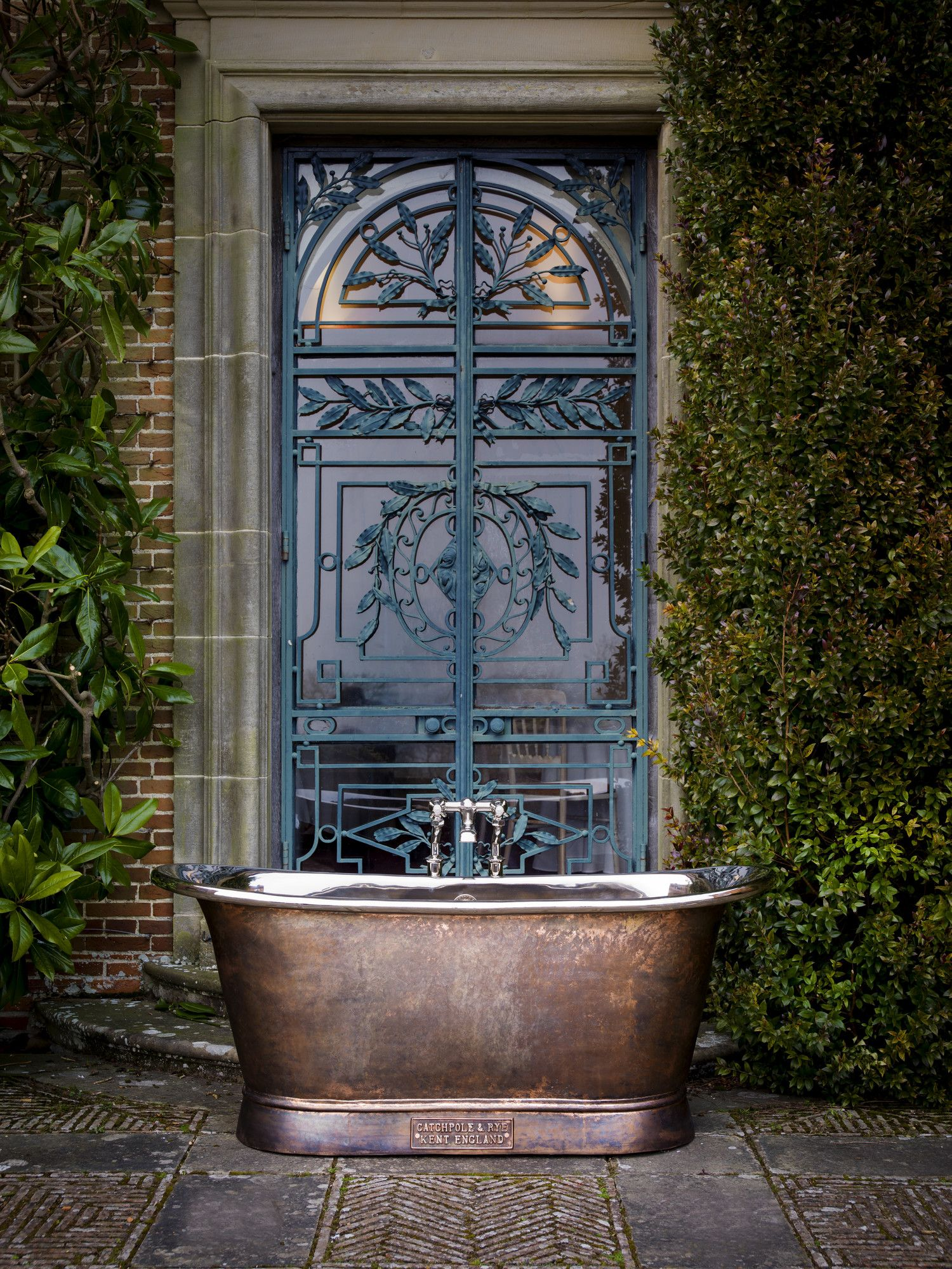 Luxury Bathrooms Kent weathered copper contrasts with highly polished nickel for an