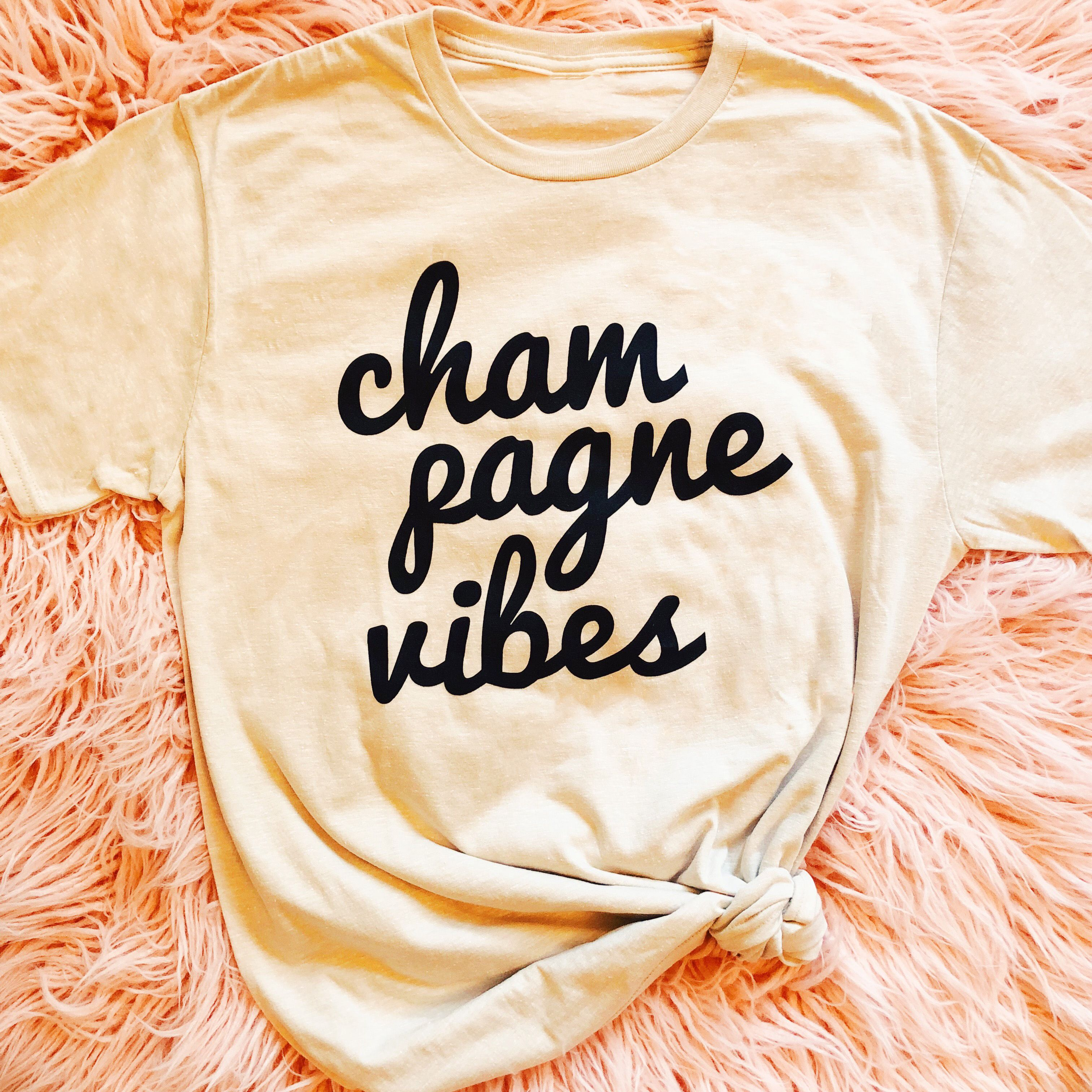 We're all about those champagne vibes. This shirt is perfect for bachelorette parties, getting ready on your wedding or to wear when you brunch it up with your gal pals! Pretty Little Things Collective
