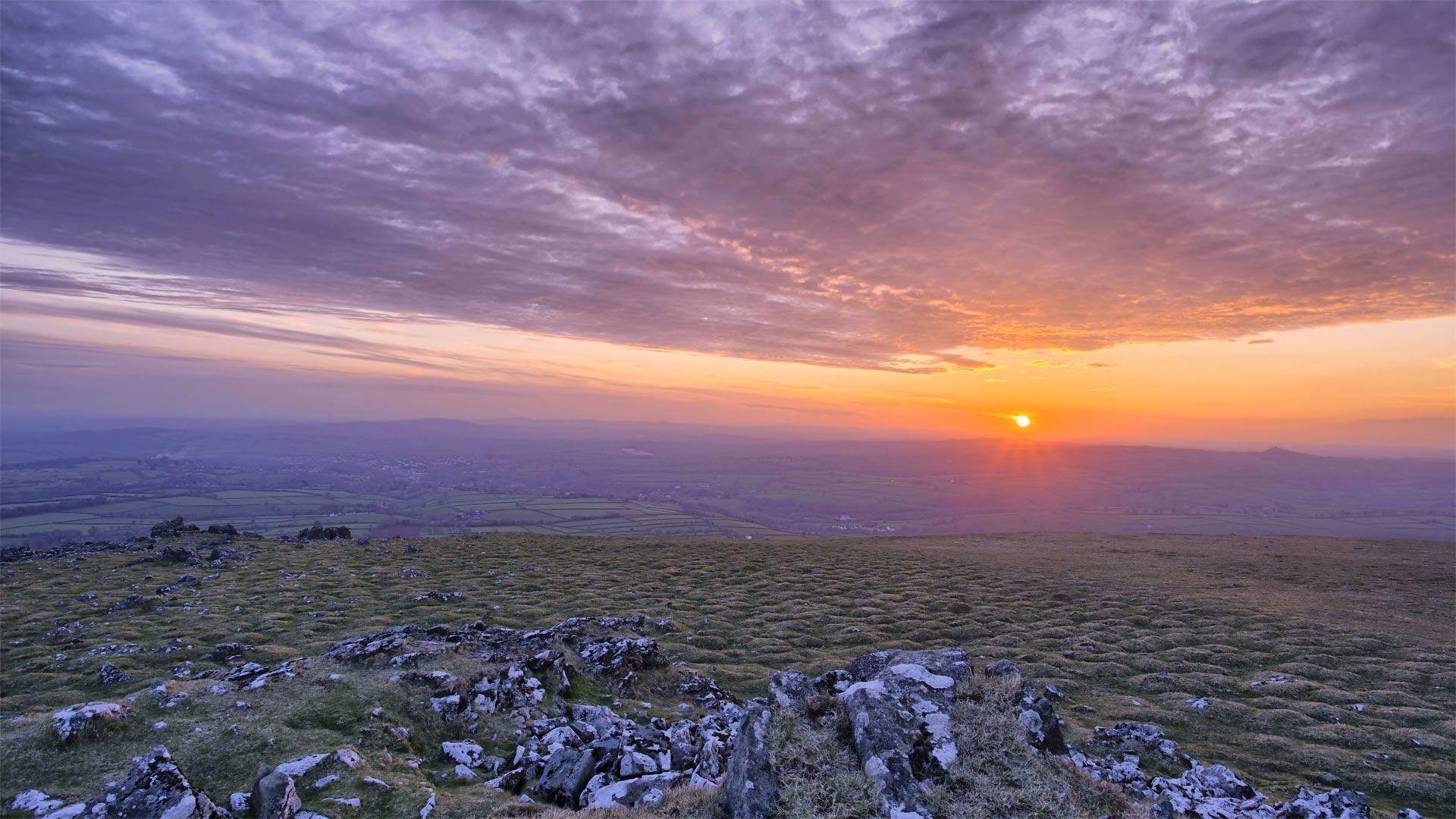 Sun setting in Dartmoor National Park, Devon, England (© Jonathan Scott/Nimia) – 2016-08-03 [http://www.bing.com/search?q=Dartmoor+National+Park&form=hpcapt&filters=HpDate:%2220160803_0700%22]