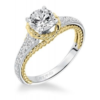 Incredible two tone white and yellow gold engagement ring with braided band details!