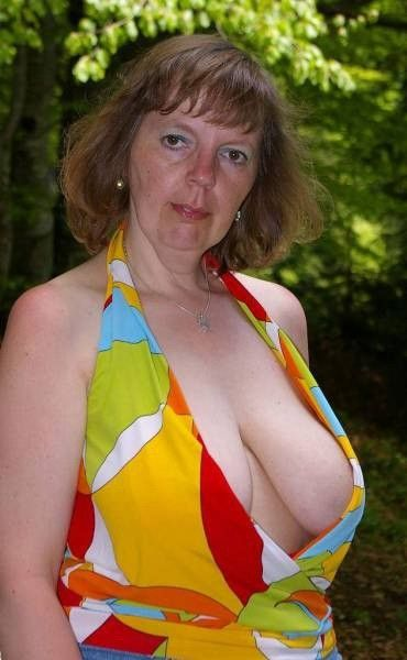 Busty mature woman with other woman