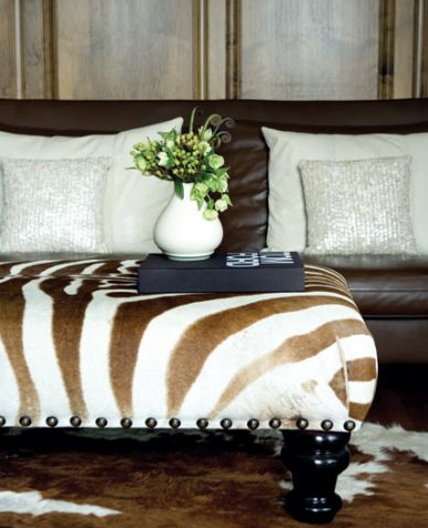 tan zebra ottoman. it adds a little spice to the room.