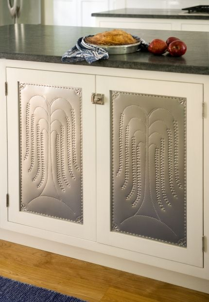 10 Stylish Ideas For Kitchen Cabinet Doors Cultivate Com A Couple Of Cabinets With Copper Cabinet Doors Galley Style Kitchen Faux Tin Tiles
