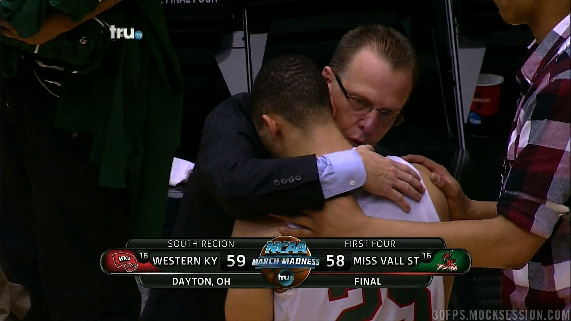 WKU Coach Ray Harper consoles MSVU's Kevin Burwell after