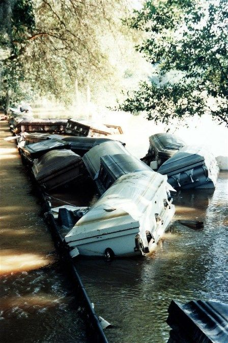 images of caskets that popped out of the saturated soil during the