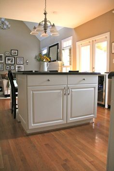 Interesting way to open up a kitchen and eliminate the table.