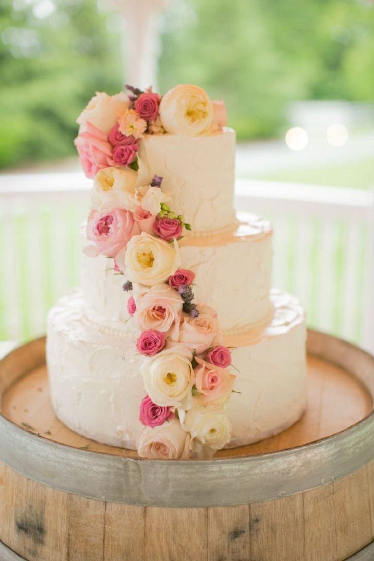 Pretty spring wedding cake with roses all over it floral spring