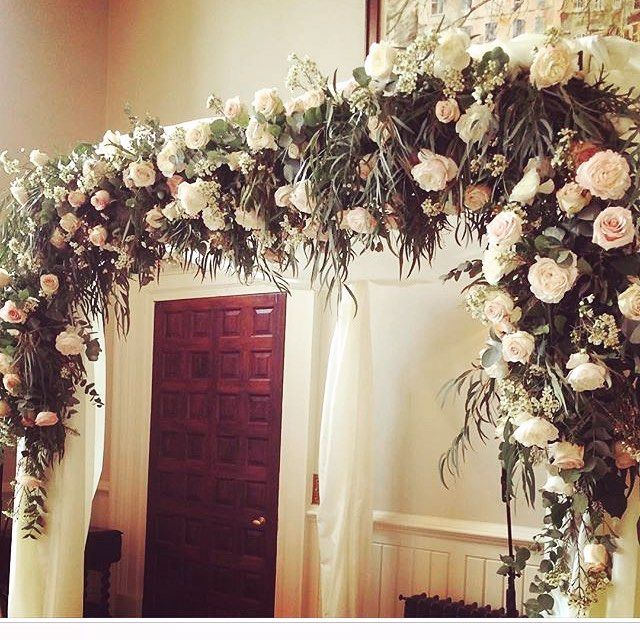 Flower arch at Elmore court which offers a most refined and elegant wedding venue option for those looking to marry in the Cotswolds.