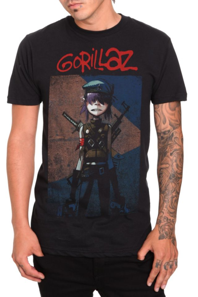 This slim-fit T-shirt features Gorillaz's guitar player, Noodle, packing some serious heat.