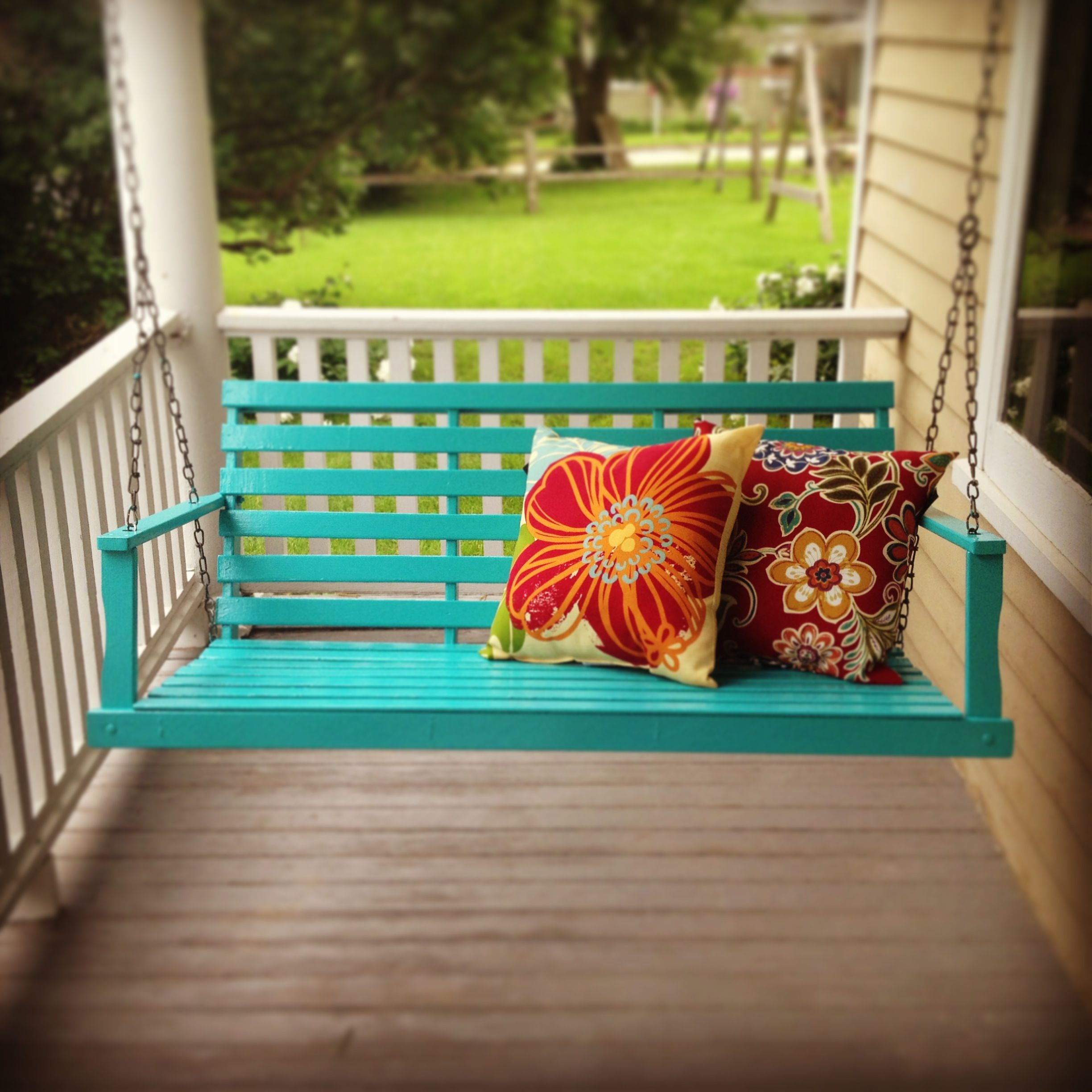 Pop Of Color On The Porch. Primed Nasty Old Wooden Swing