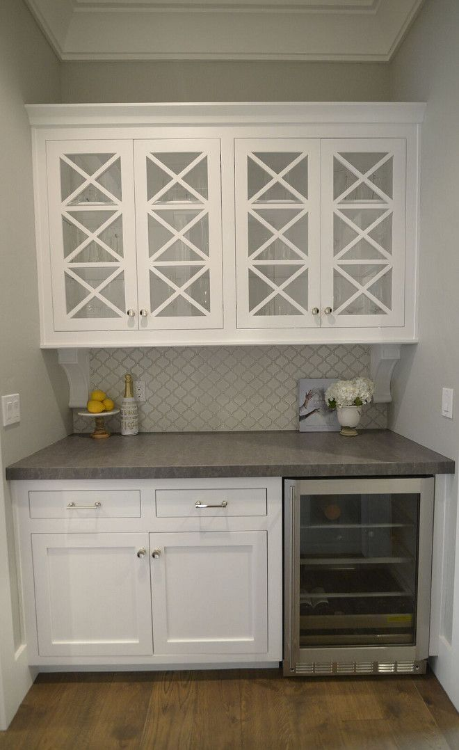 X Mullion Cabinet Doors And Gray Countertop Creates A Timeless Look