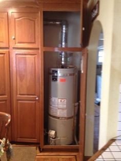 Build A Cabinet To Hide The Water Heater Just Like This Laundry Room Diy Water Heater Closet Laundry Room Makeover