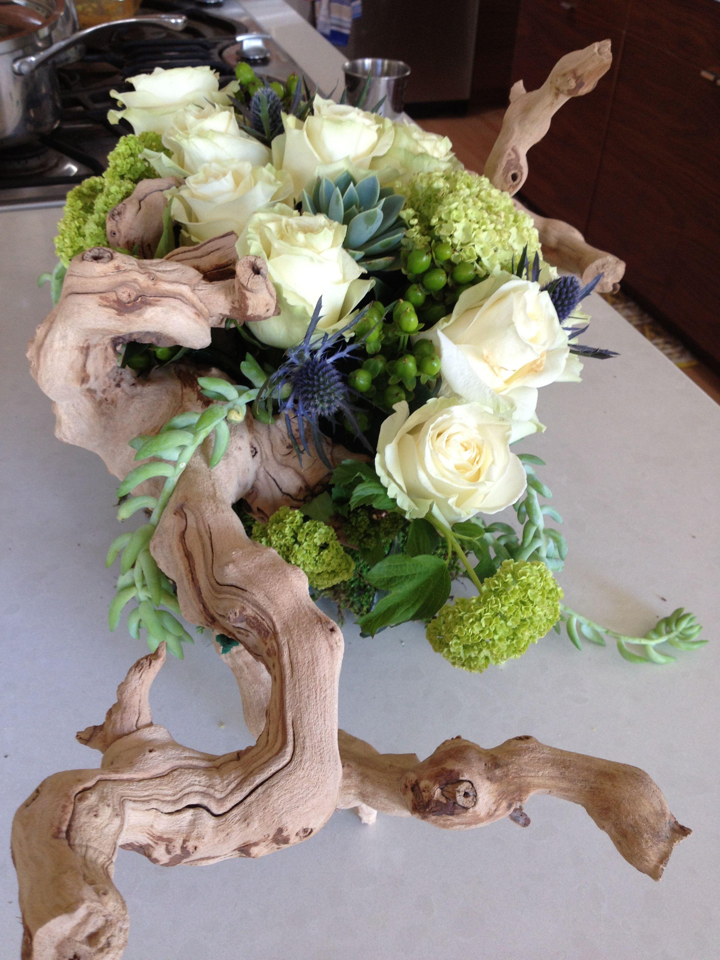 Driftwood floral arrangement Grapewood succulent wedding