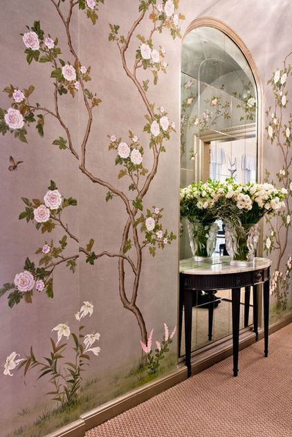 This corridor is anything but boring, decked out in hand-painted wallpaper and a recessed mirror.