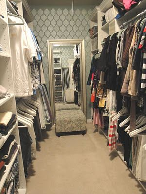 Master closet makeover with custom closet, stenciled walls, custom ottoman, and leaner mirror by New South Design