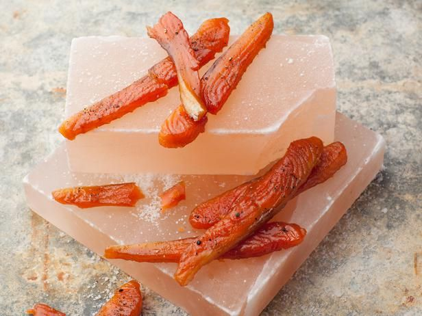 Alaska Salmon Candy -- When cured overnight, basted with a complex brown sugar, maple syrup, liquid smoke and soy sauce mixture and then slowly baked in the oven, strips of salmon become a dry, salty-sweet snack with just a hint of smoke. #AcrosstheCountry