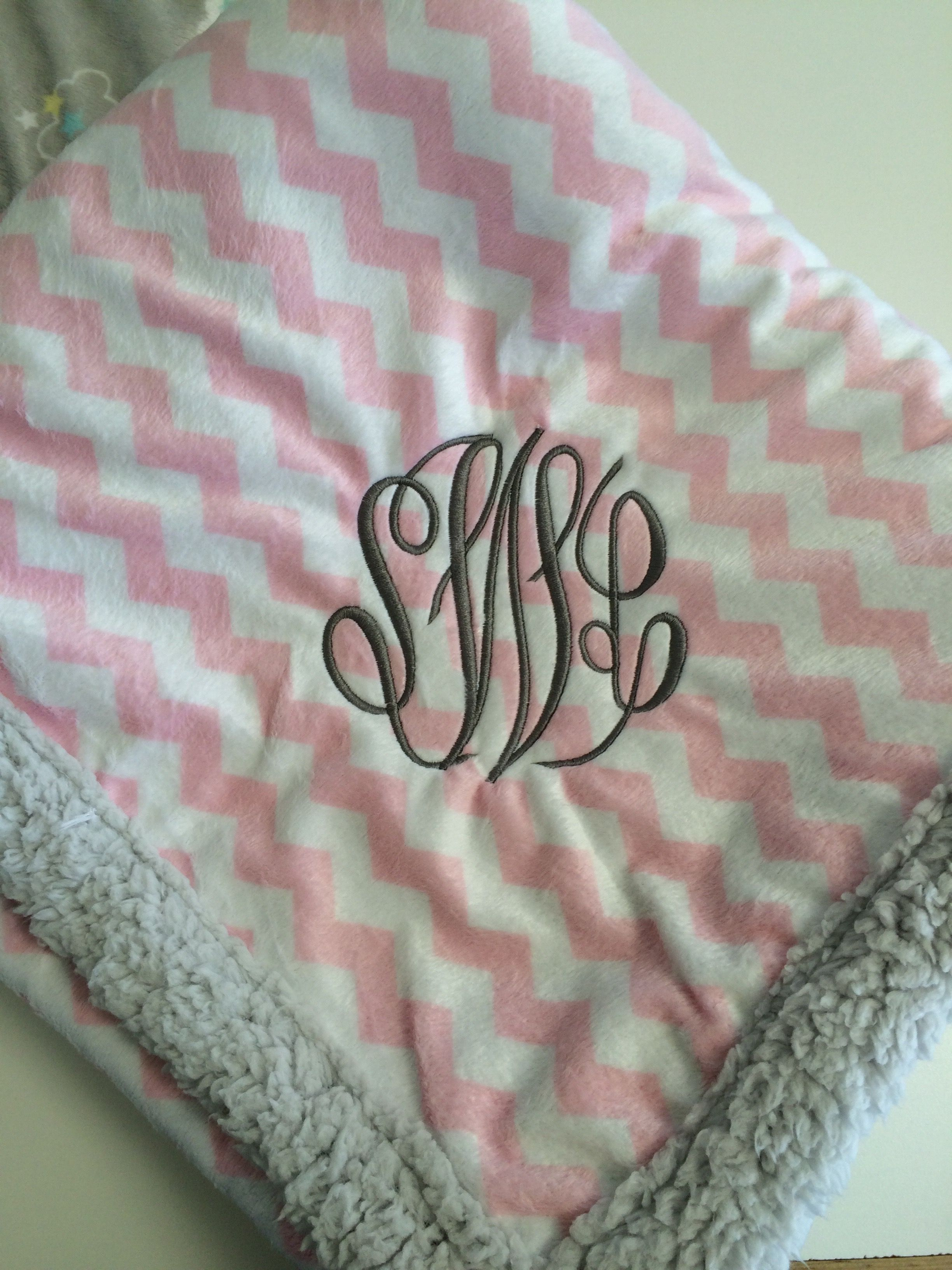 aa9328f26e Embroidered monogram on a baby blanket for a twin baby girl