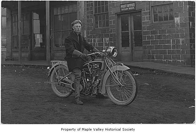 Norman on his circa 1914 Excelsior 61 c.i. twin at the Taylor WA post office (MOHAI)